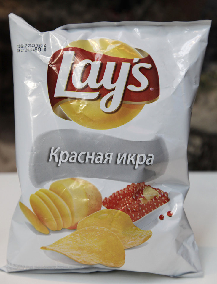 Photo -   This March 14, 2012, photo shows a package of Lays caviar potato chips in New York. While Americans might get squeamish at the thought of their favorite snacks being tweaked, what works in the U.S. doesn't work everywhere. Tastes can vary greatly in unexpected ways in different corners of the world. (AP Photo/Mark Lennihan)