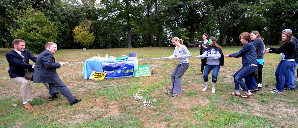 Photo -   Local groups from Pittsburgh take part in a Frackdown Smackdown tug-of-war between college students representing the