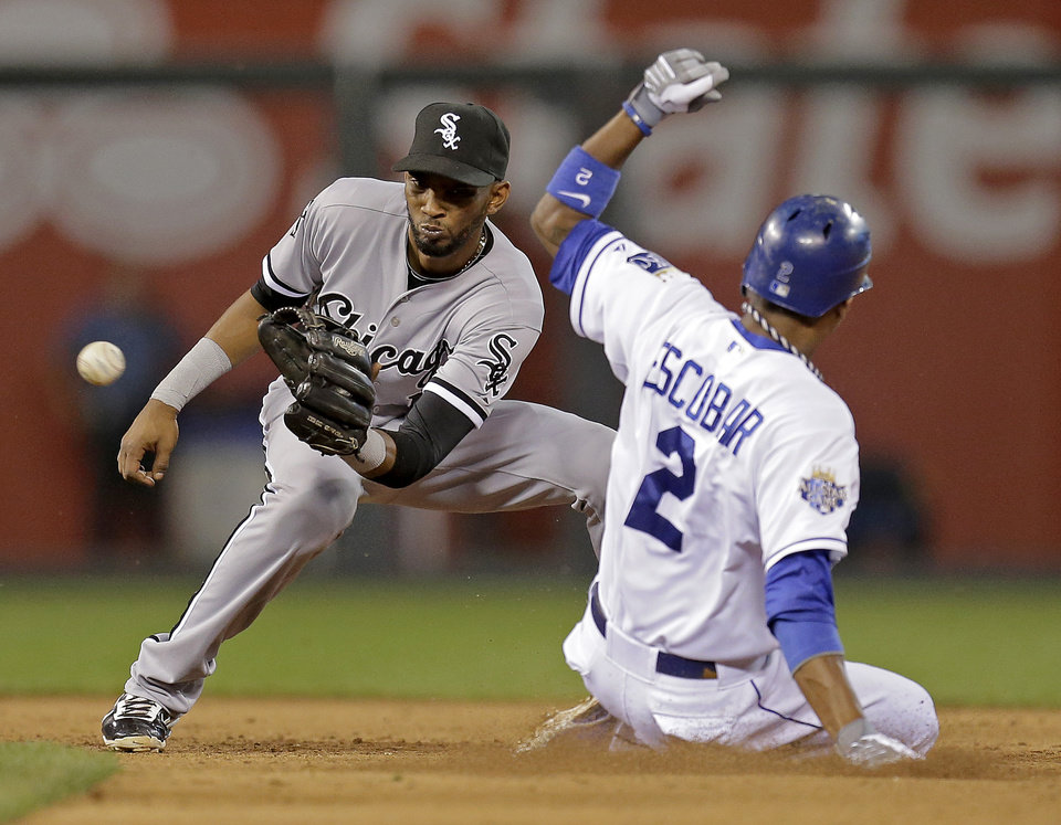 Photo -   Kansas City Royals' Alcides Escobar beats the tag by Chicago White Sox shortstop Alexei Ramirez to steal second base during the fifth inning of a baseball game Wednesday, Sept. 19, 2012, in Kansas City, Mo. (AP Photo/Charlie Riedel)