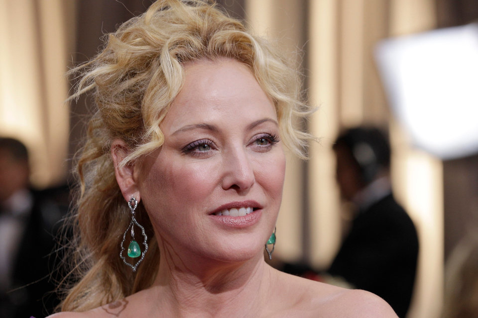 Virginia Madsen arrives before the 84th Academy Awards on Sunday, Feb. 26, 2012, in the Hollywood section of Los Angeles. (AP Photo/Amy Sancetta) ORG XMIT: OSC217