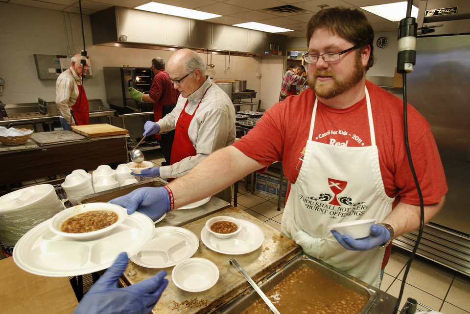 Harold Jones, left, and Chris Fourcade dish up beans as the Christian Men�s Fellowship of First Christian Church serve at the church�s annual Benefit Bean Dinner with proceeds going to the medication fund of Health for Friends on Tuesday, Jan. 22, 2013 in Norman, Okla.  Photo by Steve Sisney, The Oklahoman