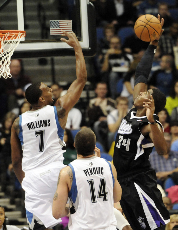 Sacramento Kings' Jason Thompson, right, tries to maintain control of the ball on a layup attempt as Minnesota Timberwolves' Derrick Williams, left, defends in the first half of an NBA basketball game Friday, Nov. 2, 2012 in Minneapolis. (AP Photo/Jim Mone)