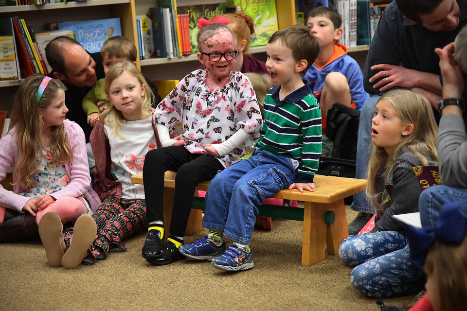 Photo - Ella and brother A.J., 3, laugh as they are recognized at a book signing at the Potomac Yards Barnes & Noble in Alexandria, Va. Photo credit: Washington Post photo by Katherine Frey.