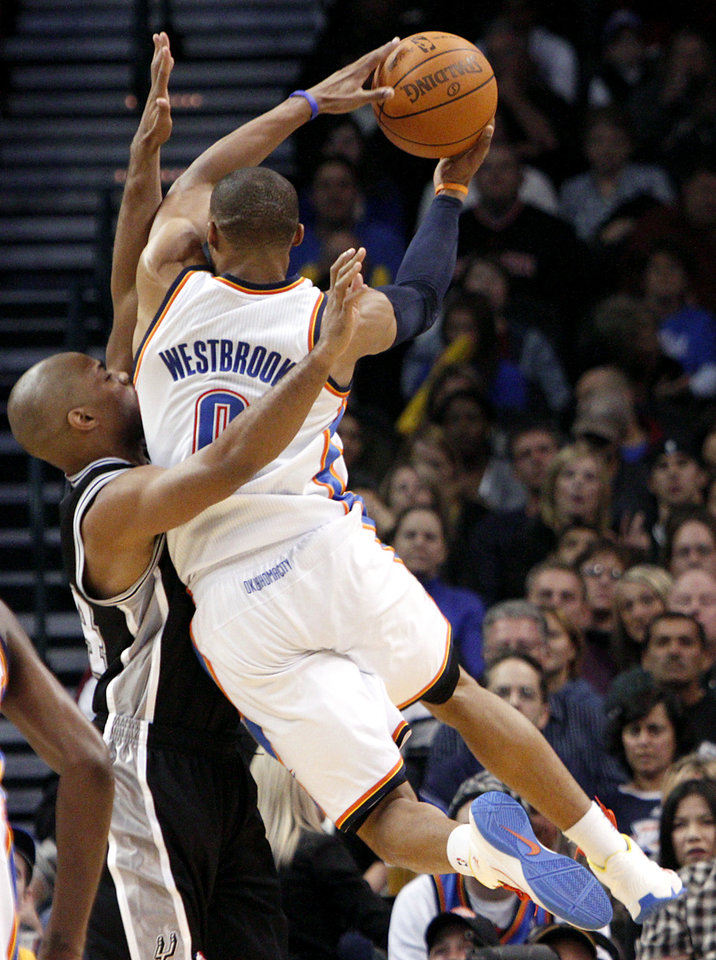 Oklahoma City's  Russell Westbrook runs into pressure from San Antonio's Richard Jefferson during their NBA basketball game in downtown Oklahoma City  on Sunday, Nov. 14, 2010. The Thunder lost to the Spurs 117-104. Photo by John Clanton, The Oklahoman