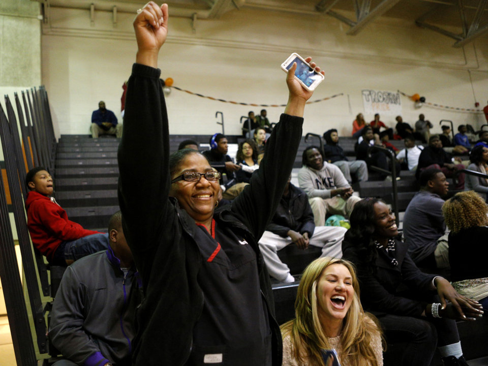 Photo - Dorshell Clark cheers beside her friend Jennifer Spurlock during her son's, Deondre Clark's, basketball game at Douglass High School in Oklahoma City, Tuesday, January 28, 2014. Photo by Bryan Terry, The Oklahoman