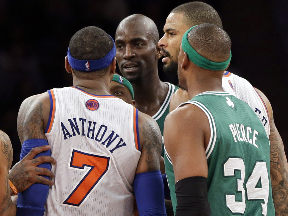 In this photo taken Monday, Jan. 7, 2013, New York Knicks\' Carmelo Anthony (7) and Boston Celtics\' Kevin Garnett, center, exchange words after both received technical fouls as Celtics\' Paul Pierce (34) and Knicks\' Tyson Chandler look on during the second half of an NBA basketball game at Madison Square Garden in New York. Anthony said Tuesday, he lost his cool after Garnett said things to him that he feels shouldn\'t be said to