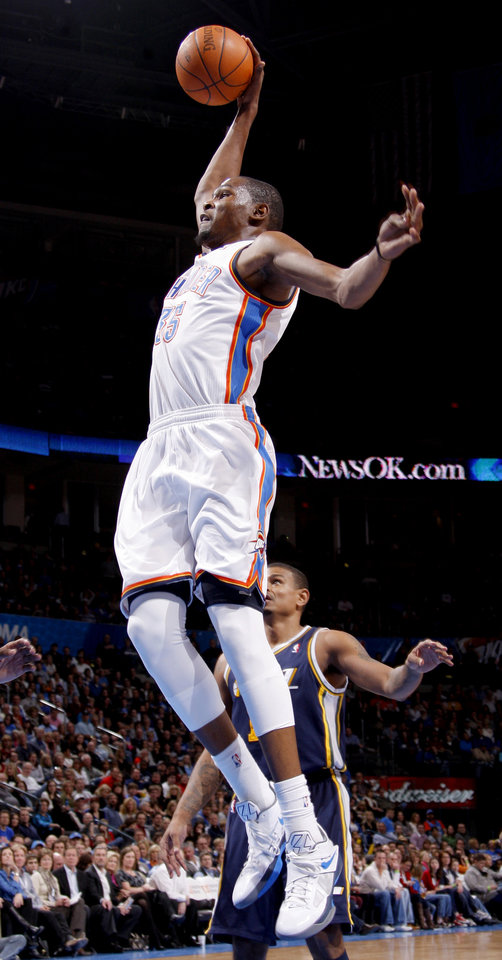 Photo - Oklahoma City's Kevin Durant (35) goes up for a dunk during an NBA game between the Oklahoma City Thunder and the Utah Jazz at Chesapeake Energy Arena in Oklahoma CIty, Tuesday, Feb. 14, 2012. Photo by Bryan Terry, The Oklahoman