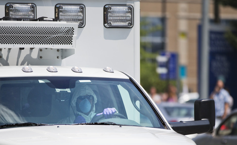 Photo - An ambulance transporting Nancy Writebol, an American missionary stricken with Ebola, arrives at Emory University Hospital, Tuesday, Aug. 5, 2014, in Atlanta. Writebol is expected to be admitted to Emory University Hospital on Tuesday, where she will join another U.S. aid worker, Dr. Kent Brantly, in a special isolation unit. (AP Photo/David Goldman)