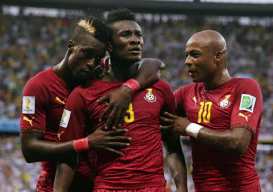 Photo - Ghana's Asamoah Gyan, center, celebrates with his teammates after scoring his side's second goal during the group G World Cup soccer match between Germany and Ghana at the Arena Castelao in Fortaleza, Brazil, Saturday, June 21, 2014. (AP Photo/Marcio Jose Sanchez)