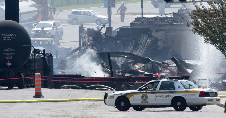 Photo - Burnt buildings are seen following a train derailment causing explosions of railway cars carrying crude oil Sunday, July 7, 2013 in Lac Megantic, Quebec. Two more bodies were discovered overnight after a runaway train carrying crude oil derailed in eastern Quebec, igniting explosions and fires that destroyed a town's downtown center. The confirmed death toll is now three, and is expected to rise further. (AP Photo/The Canadian Press, Paul Chiasson