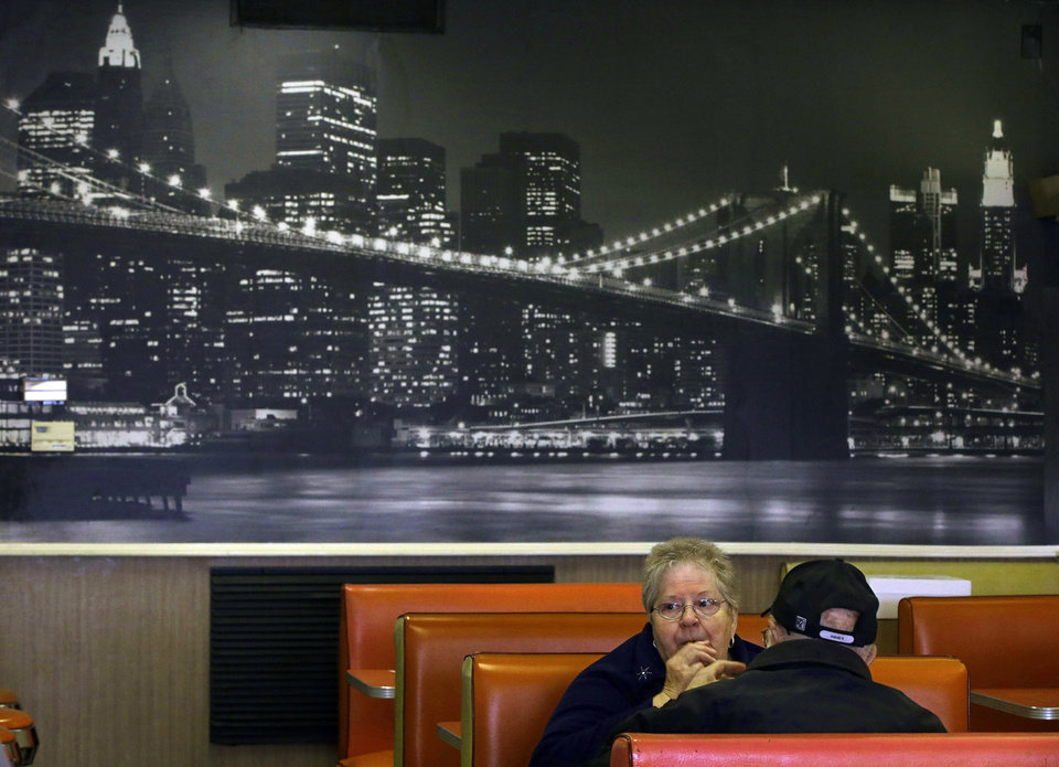 Photo - TAKES OUT HOT DOG REFERENCE - In this Monday, March 3, 2014 photo Joan Vear and John Iaciofano eat lunch under a mural of New York City's  Brooklyn Bridge at Olneyville New York System of Providence in Providence, RI. The James Beard Foundation named the Rhode Island restaurant one of five