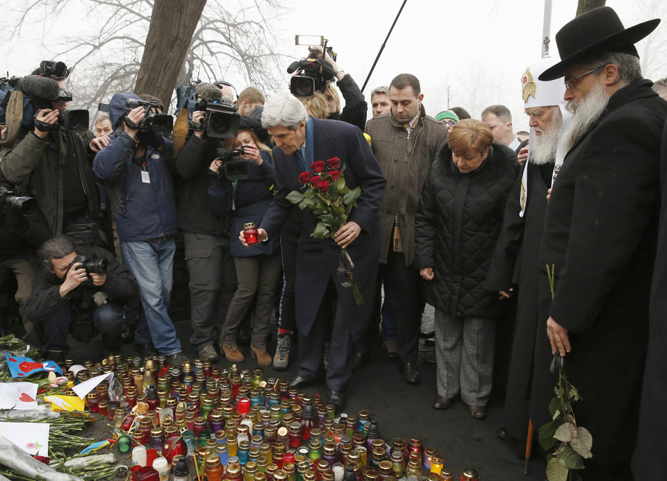 Photo - Secretary of State John Kerry places a candle and roses atop the Shrine of the Fallen in Kiev, Ukraine, Tuesday, March 4, 2014. The Shrine of the Fallen, located on Institutska Street, honors the fallen Heroes of the