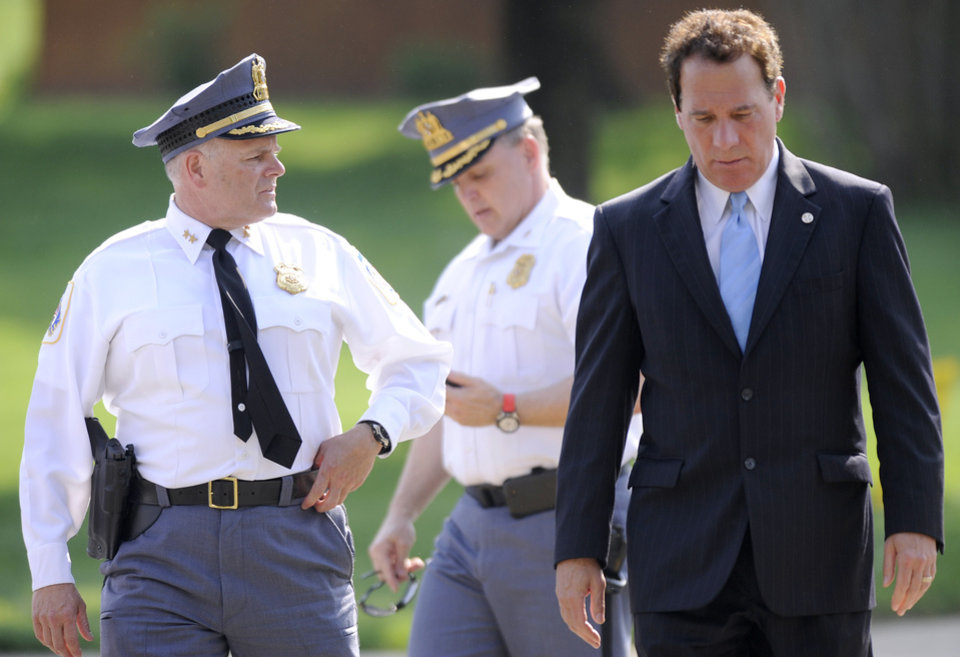 Photo - From left, Baltimore County Police Chief Jim Johnson, Baltimore County Police Col. Peter Evans and Baltimore County Executive Kevin Kamenetz arrive for a news conference outside WMAR-TV Tuesday, May 13, 2014, in Towson, Md. The officials announced that a man was taken into custody after allegedly crashing a vehicle into the television station. (AP Photo/Steve Ruark)