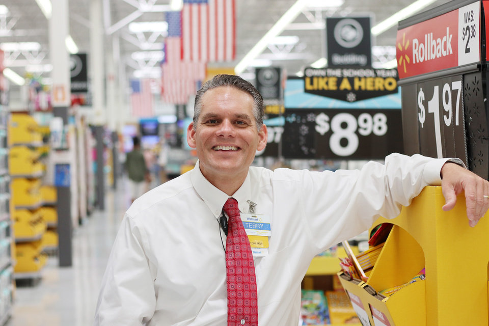 Photo -  Terry Tschoepe is store manager at the Belle Isle Walmart. [Photo by Doug Hoke, The Oklahoman]