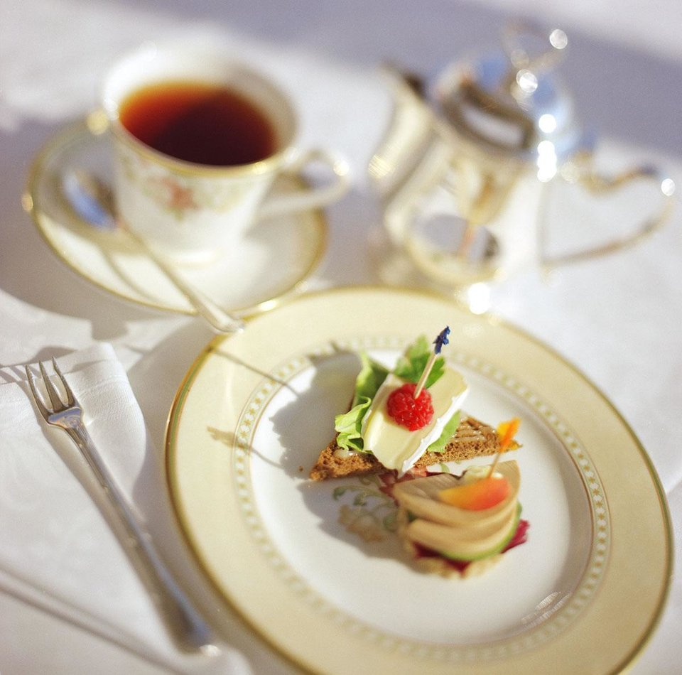 Photo - This undated photo provided by Crystal Cruises shows afternoon tea on a Crystal ship. The elegance of luxury cruising can be combined with active adventures on trips that offer excursions such as bike tours in port. (AP Photo/Crystal Cruises)