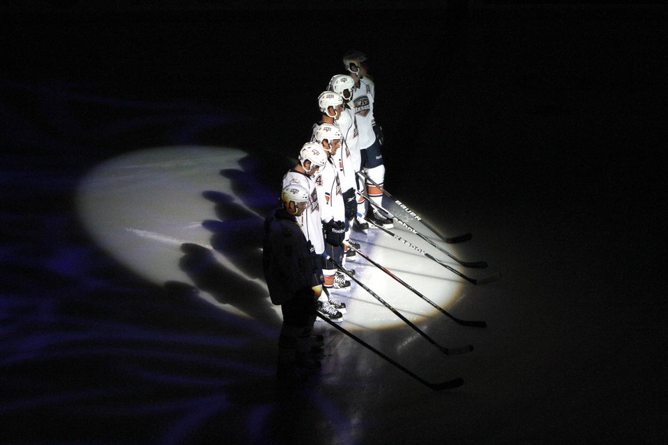 Photo - The Barons are introduced during the AHL game between the Oklahoma City Barons and the Houston Aeros, Saturday, Oct. 9, 2010, at the Cox Convention Center in Oklahoma City. Photo by Sarah Phipps, The Oklahoman