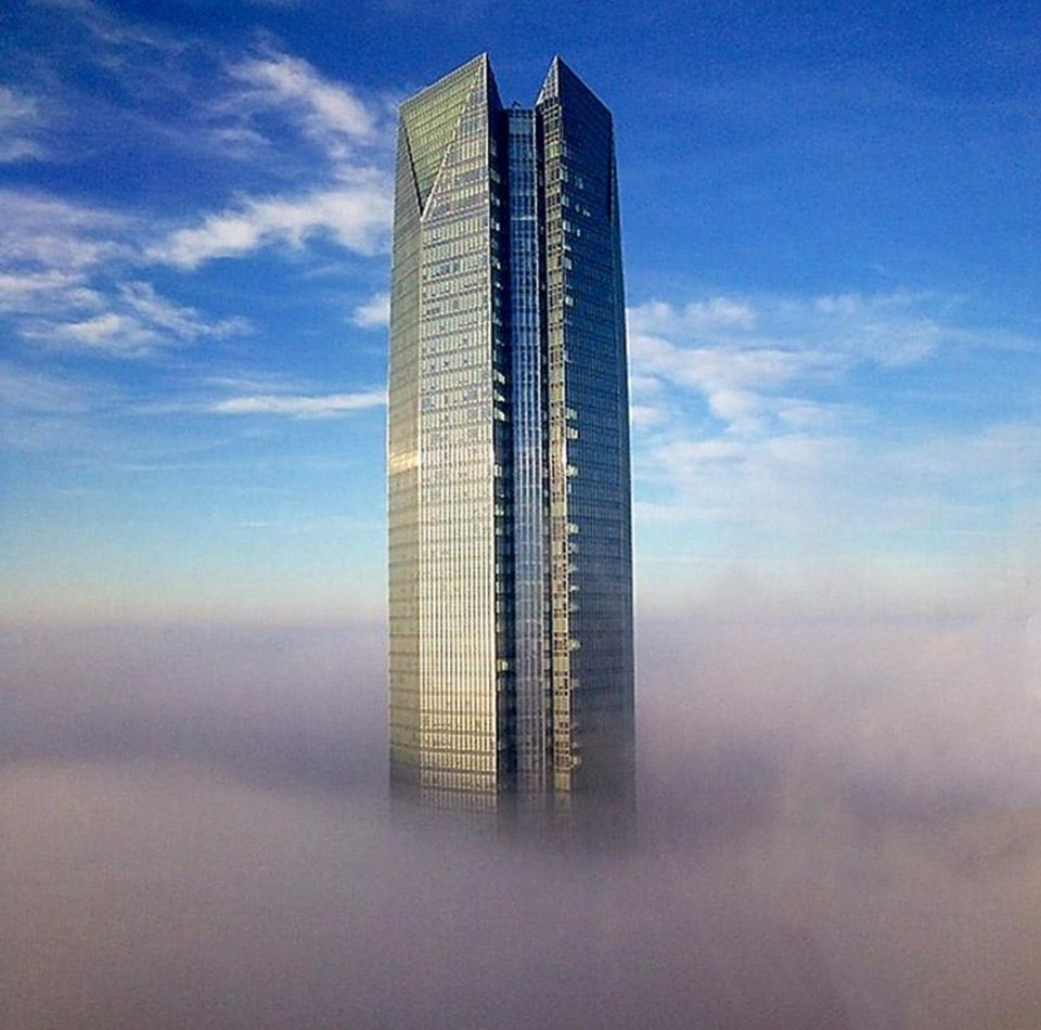 Photo - View of the Devon tower surrounded by ground fog Monday morning in downtown Oklahoma City, Dec 2, 2013. Photo by Logan Beall.