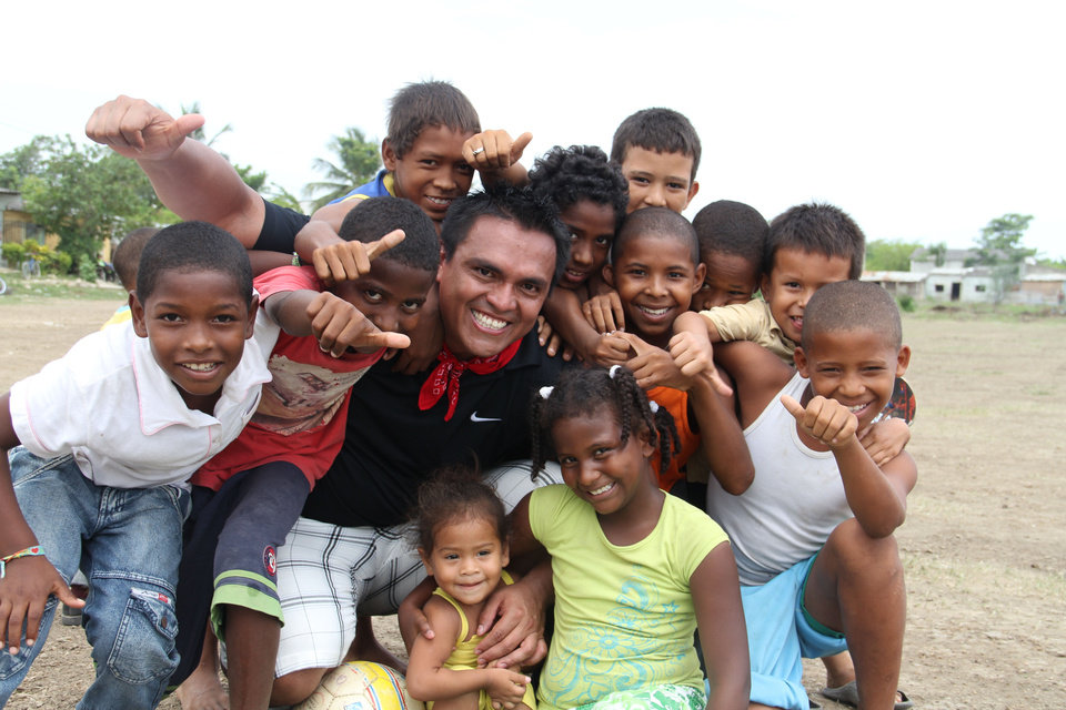 Photo - Smiling children surround Edwin Amaya in Cartagena, Colombia. Amaya is the founder of the Smile Colombia Foundation. PHOTO PROVIDED