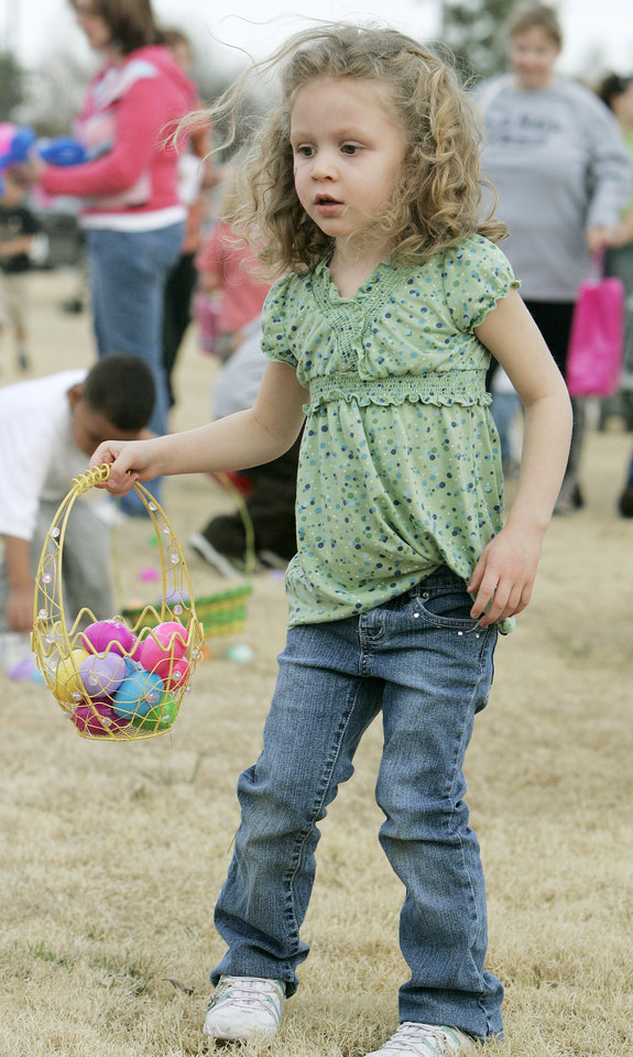 Photo - Kayman Ross, 4, of Choctaw  has her basketfull of eggs at the Sam Noble Oklahoma Museum of Natural History Easter egg hunt festivities Wed. March 12, 2008 in Norman, OK. BY JACONNA AGUIRRE/THE OKLAHOMAN
