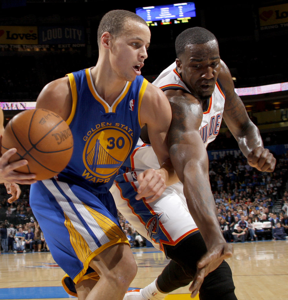Photo - Oklahoma City's Kendrick Perkins (5) defends Golden State's Stephen Curry (30) during the NBA basketball game between the Oklahoma City Thunder and the Golden State Warriors at the Oklahoma City Arena, Tuesday, March 29, 2011. Photo by Bryan Terry, The Oklahoman