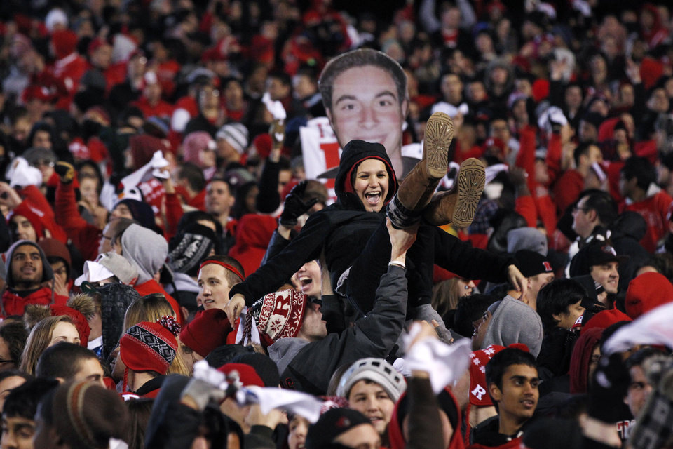 Fans celebrate a Rutgers touchdown during the first half of an NCAA college football game against Louisville in Piscataway, N.J., Thursday, Nov. 29, 2012. (AP Photo/Mel Evans)