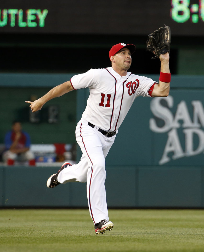 Photo - Washington Nationals left fielder Ryan Zimmerman catches a fly ball hit by Philadelphia Phillies' Chase Utley during the fourth inning of a baseball game at Nationals Park Tuesday, June 3, 2014, in Washington. (AP Photo/Alex Brandon)