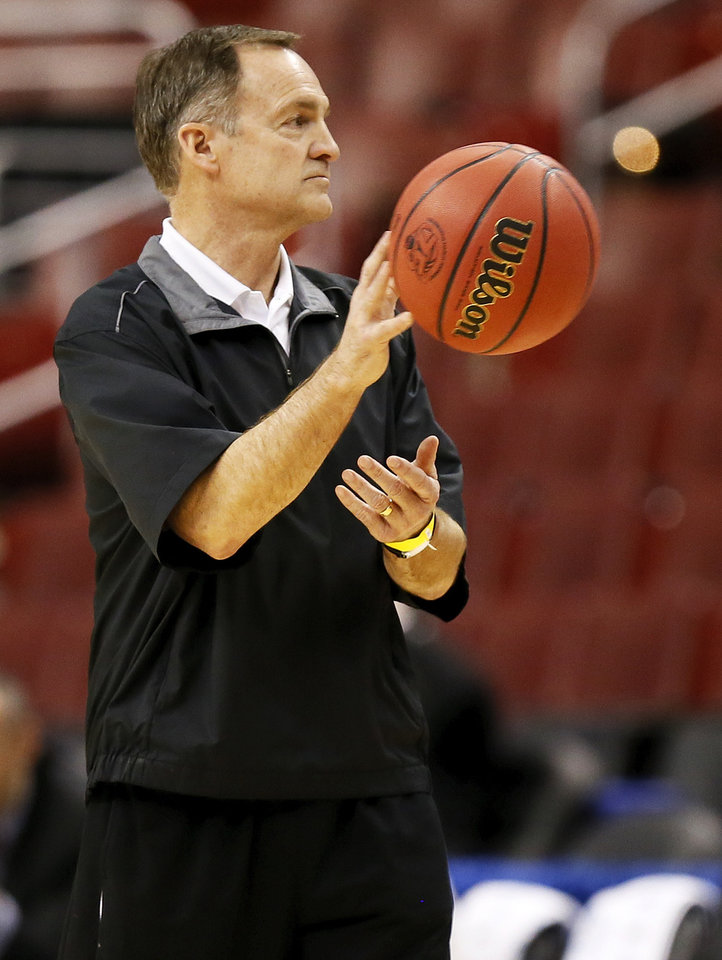 Oklahoma coach Lon Kruger passes a basketball during the practice and press conference day for the second round of the NCAA men's college basketball tournament at the Wells Fargo Center in Philadelphia, Thursday, March 21, 2013. OU will play San Diego State in the second round on Friday. Photo by Nate Billings, The Oklahoman