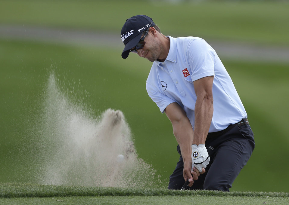 Photo - Adam Scott, of Australia, blasts out of the sand trap on the seventh hole during the second round of the Arnold Palmer Invitational golf tournament at Bay Hill Friday, March 21, 2014, in Orlando, Fla. (AP Photo/Chris O'Meara)