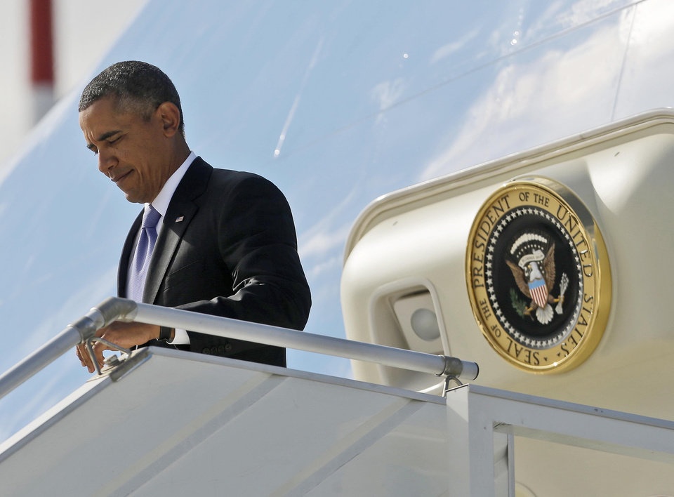 Photo - US President Barack Obama during his arrival at Pulkovo International Airport on Air Force One, Thursday, Sept. 5, 2013, in St. Petersburg, Russia. Obama traveled to Russia to attend the G20 Summit. (AP Photo/Pablo Martinez Monsivais)