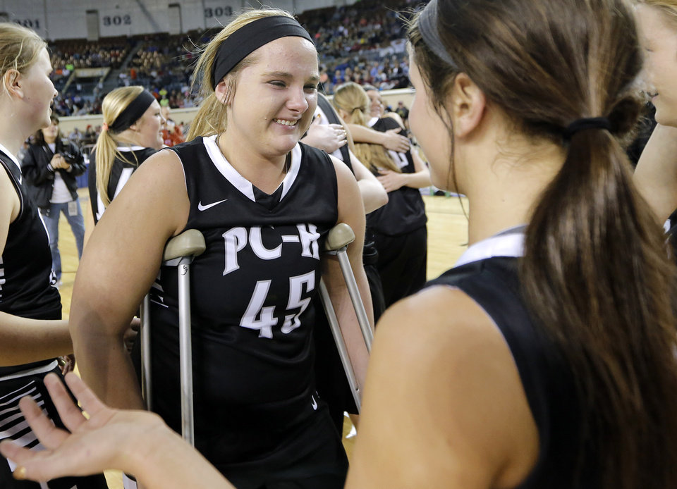 Photo - Tears roll down the cheek of Pond Ceek-Hunter's Taylor Fetters (45) as the Lady Panthers celebrate the win in the Class A girls high school basketball state championship game between Seiling and Pond Creek-Hunter at the State Fair Arena in Oklahoma City, Okla., on Saturday, March 8, 2014.  Photo by Chris Landsberger, The Oklahoman