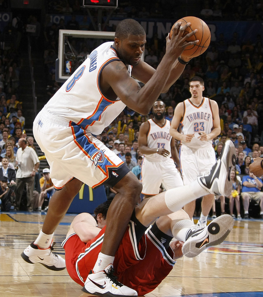 Oklahoma City's Nazr Mohammed (8) grabs the ball over Milwaukee's Ersan Ilyasova (7) during the NBA basketball game between the Oklahoma City Thunder and the Milwaukee Bucks at the Oklahoma City Arena, Wednesday, April 13, 2011. Photo by Bryan Terry, The Oklahoman