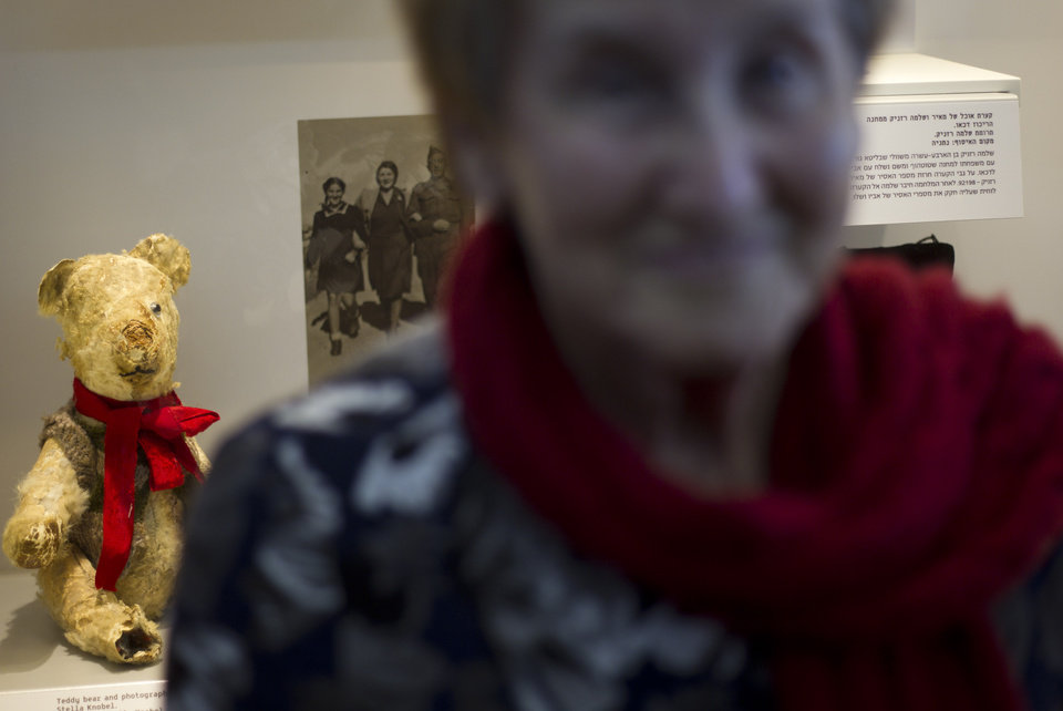 "Holocaust survivor Stella Knobel, poses next to her teddy bear during a new exhibition of Israel's national Holocaust memorial and museum in Jerusalem, Sunday, Jan. 27, 2013. When Stella Knobel's family had to flee World War II Poland in 1939, the only thing the 7-year-old girl could take with her was her teddy bear. For the next six years, the stuffed animal never left her side as the family wondered through the Soviet Union, to Iran and finally the Holy Land. ""He was like family. He was all I had. He knew all my secrets,"" the 80-year-old now says with a smile. ""I saved him all these years. But I worried what would happen to him when I died."" So when she heard about a project launched by Israel's national Holocaust memorial and museum to collect artifacts from aging survivors - before they, and their stories, were lost forever - she reluctantly handed over her beloved bear Misiu - Polish for �Teddy Bear�- so the fading memories of the era could be preserved for others. (AP Photo/Ariel Schalit)"