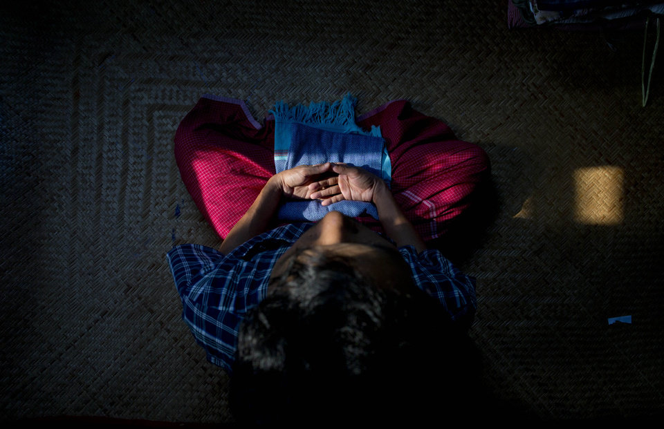 In this March 25, 2013 photo, San Zaw Htwe meditates in his room in Yangon, Myanmar. The former political prisoner will turn 39 on Saturday, March 30, the second anniversary of the day President Thein Sein took office and pledged to transform Myanmar from a military dictatorship to a free-market democracy. Thein Sein's administration has made remarkable progress toward that goal, but at a price that San Zaw Htwe knows only too well: forgetting the past. (AP Photo/Gemunu Amarasinghe)