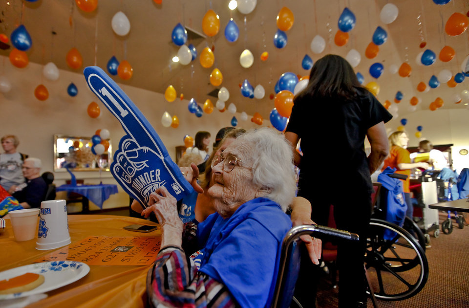 O'Dell Medley wears a foam hand to show support for the Thunder as she prepares to play bingo during the Oklahoma City Thunder's 1000th community appearance at Ranchwood Nursing Home on Tuesday, Nov. 27, 2012, in Yukon, Okla.   Photo by Chris Landsberger, The Oklahoman
