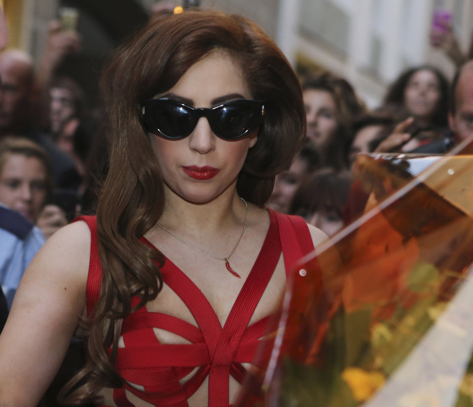 Photo -   US performer Lady Gaga arrives at the Versace atelier in Milan, Italy, Moday, Oct. 1, 2012. Lady Gaga will stage the only Italian concert of her tour in Milan Tuesday. (AP Photo/Luca Bruno)