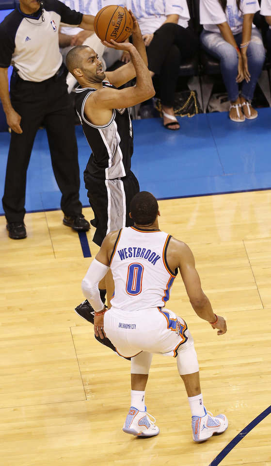 Photo - San Antonio's Tony Parker (9) shoots in front of Oklahoma City's Russell Westbrook (0) during Game 6 of the Western Conference Finals in the NBA playoffs between the Oklahoma City Thunder and the San Antonio Spurs at Chesapeake Energy Arena in Oklahoma City, Saturday, May 31, 2014. Photo by Nate Billings, The Oklahoman