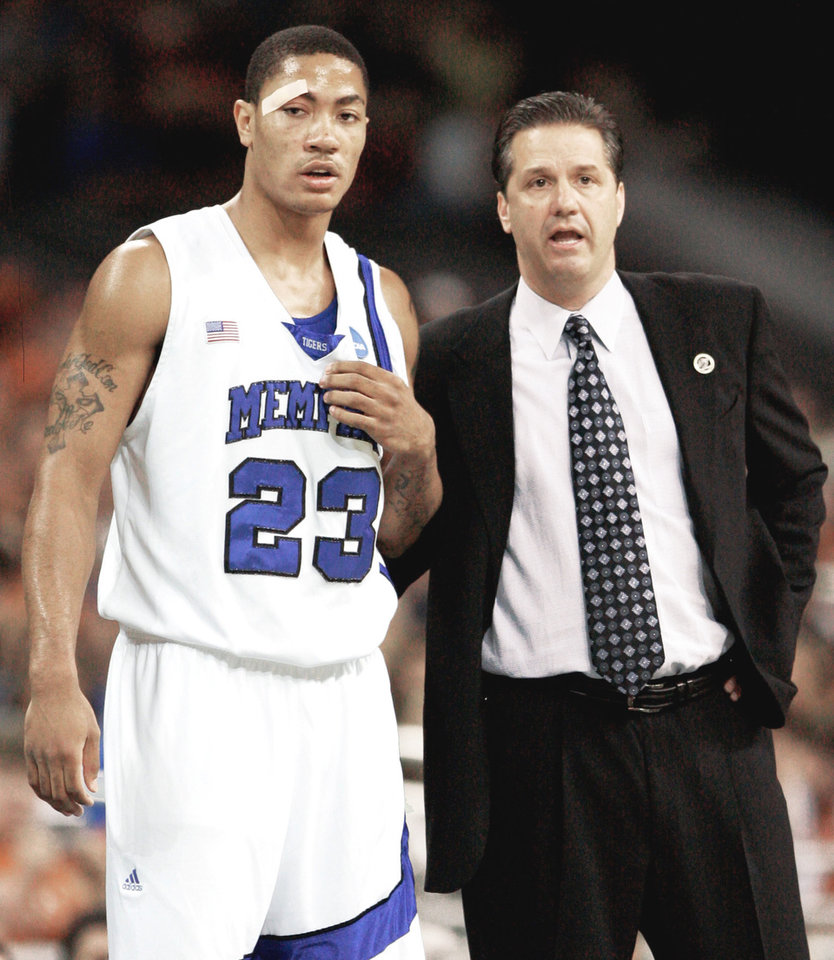 Photo - Memphis coach John Calipari talks with guard Derrick Rose. AP photo