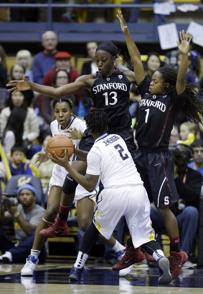 Photo - Stanford forward Chiney Ogwumike (13) and guard Lili Thompson (1) defend on California guard Afure Jemerigbe (2) during the first half on an NCAA college basketball game on Sunday, Feb. 2, 2014, in Berkeley, Calif. (AP Photo/Marcio Jose Sanchez)