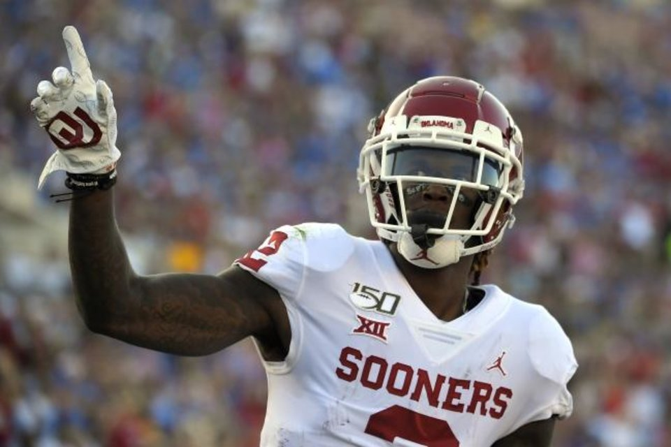 Photo -  Oklahoma wide receiver CeeDee Lamb celebrates after scoring a touchdown during the first half of the Sooners' 48-14 win over UCLA on Saturday in Pasadena, Calif. [AP Photo]