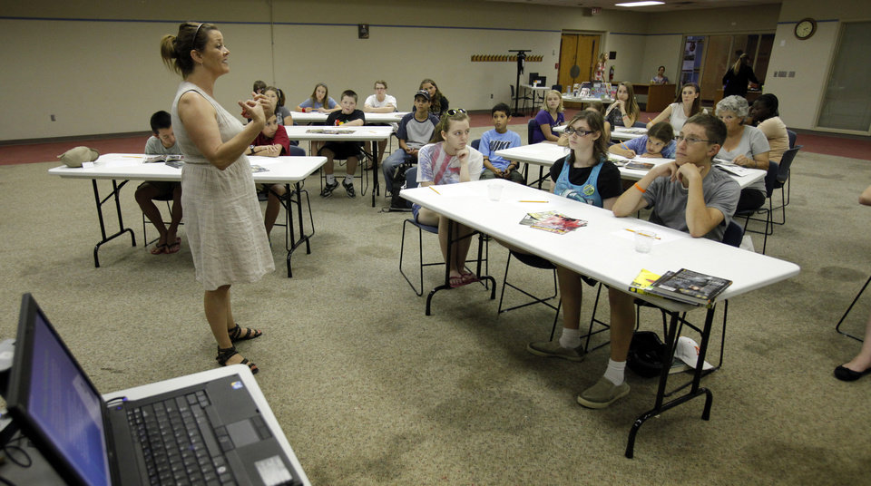Jennifer Johnson from University of Oklahoma (OU) Writing Center leads teens in a comic book character workshop on Tuesday, June 26, 2012, in Norman, Okla.  Photo by Steve Sisney, The Oklahoman