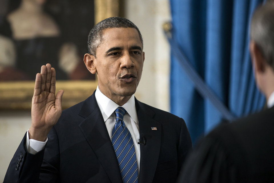President Barack Obama is officially sworn-in by Chief Justice John Roberts in the Blue Room of the White House during the 57th Presidential Inauguration in Washington, Sunday, Jan. 20, 2013. (AP Photo/Brendan Smialowski, Pool) ORG XMIT: WX401