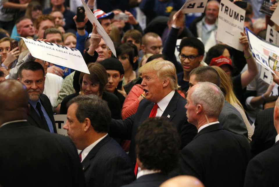 Photo - Republican presidential candidate Donald Trump greets a crowd after a rally at the Cox Convention Center in Oklahoma City, Friday, Feb. 26, 2016. Photo by Bryan Terry, The Oklahoman