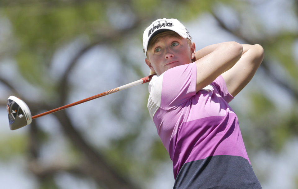Stacy Lewis watches her tee shot on the first hole during the final round of the North Texas LPGA Shootout golf tournament at Las Colinas Country Club in Irving, Texas, Sunday, May 4, 2014. (AP Photo/LM Otero)