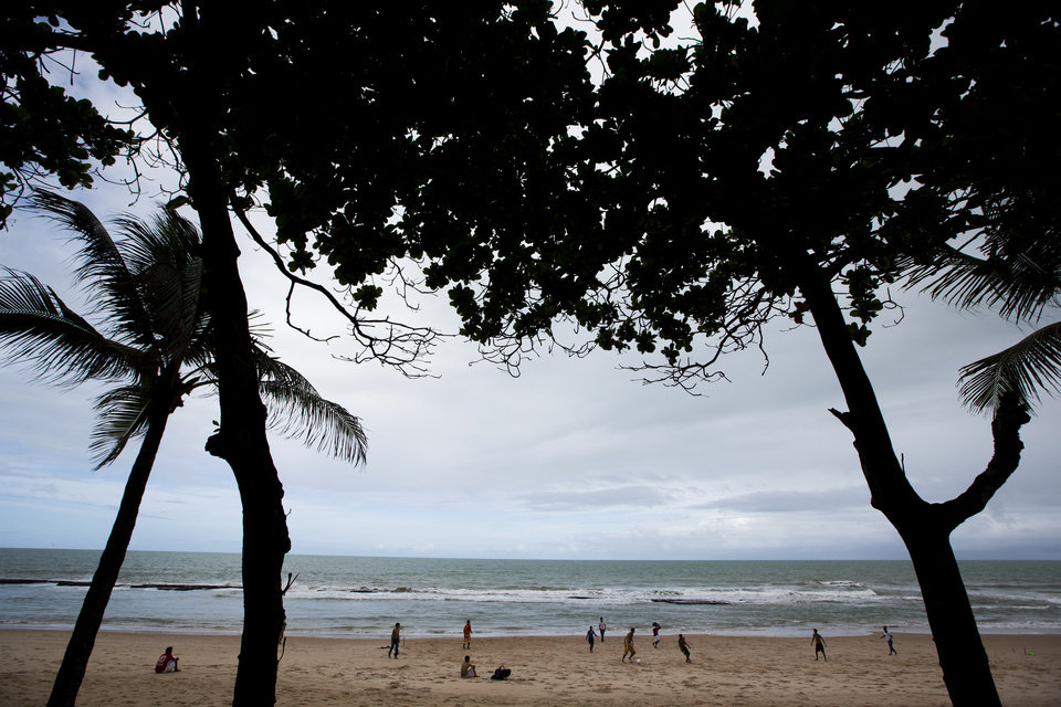 FILE - This June 13, 2013 file photo shows people playing soccer on the beach in Recife, Brazil. Refice will host matches of the 2014 soccer World Cup. (AP Photo/Victor R. Caivano, File)