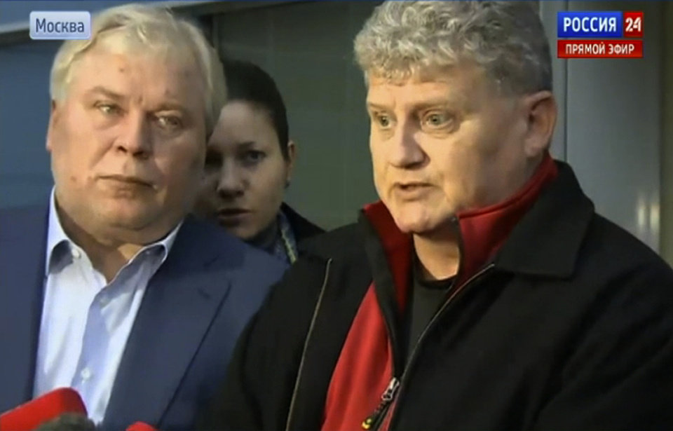 Photo - In this frame grab made available by Rossia 24 TV channel on Thursday, Oct. 10, 2013 Lon Snowden, right, speaks outside Moscow's Sheremetyevo airport. Edward Snowden's father Lon Snowden told Russian television outside the Moscow airport Thursday morning that his son is not planning to return to the United States. Lon Snowden thanked Russia and President Vladimir Putin for sheltering his son. He would not say when or where he will be meeting his son. Edward Snowmen's lawyer Anatoly Kucherena listens at left. (AP Photo/ Rossia 24 TV channel) TV OUT
