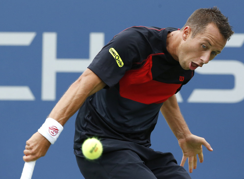 Photo - Philipp Kohlschreiber, of Germany, returns a shot against John Isner, of the United States, during the third round of the 2014 U.S. Open tennis tournament, Saturday, Aug. 30, 2014, in New York. (AP Photo/Kathy Willens)