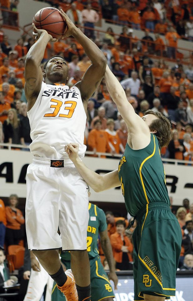 Oklahoma State 's Marcus Smart (33) shoots over Baylor's Brady Heslip (5) during the college basketball game between the Oklahoma State University Cowboys (OSU) and the Baylor University Bears (BU) at Gallagher-Iba Arena on Wednesday, Feb. 5, 2013, in Stillwater, Okla. Photo by Chris Landsberger, The Oklahoman
