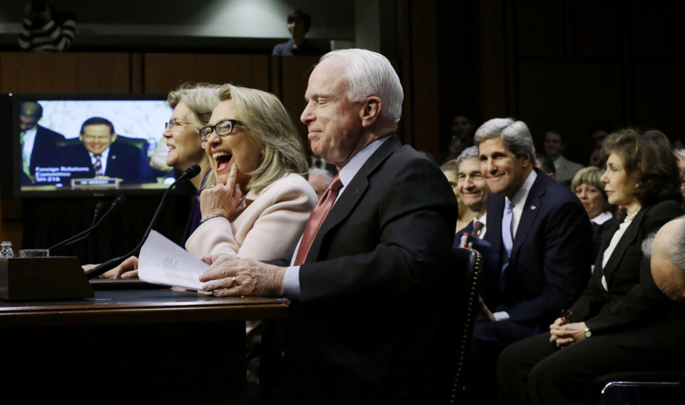 Senate Foreign Relations Chairman Sen. John Kerry, D-Mass., second from right, and his wife Teresa Heinz, right, watch as Secretary of State Hillary Rodham Clinton, center, flanked by Sen. Elizabeth Warren, D-Mass., left , and Sen. John McCain, R-Ariz, reacts during the start of his Kerry\'s confirmation hearing to replace Clinton, Thursday, Jan. 24, 2013, on Capitol Hill in Washington. (AP Photo/Pablo Martinez Monsivais)