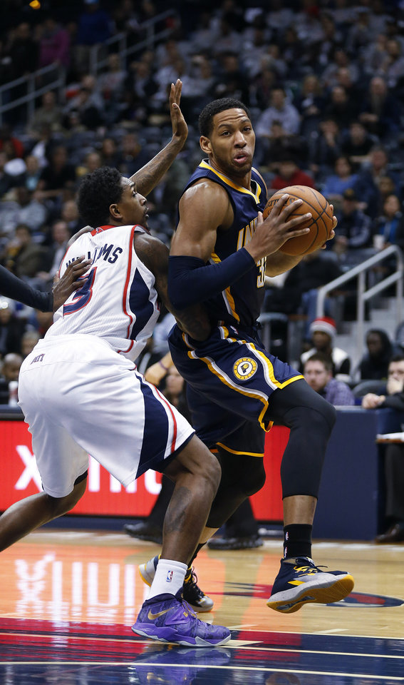 Photo - Indiana Pacers small forward Danny Granger (33) drives against Atlanta Hawks shooting guard Louis Williams (3) in the first  half of an NBA basketball game, Tuesday, Feb. 4, 2014, in Atlanta. (AP Photo/John Bazemore)