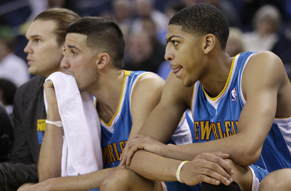 New Orleans Hornets power forward Anthony Davis, right, sits on the bench with point guard Greivis Vasquez, from Venezuela, center, and power forward Lou Amundson during the fourth quarter of an NBA basketball game against the Golden State Warriors in Oakland, Calif., Wednesday, April 3, 2013. The Warriors won 98-88. (AP Photo/Jeff Chiu)